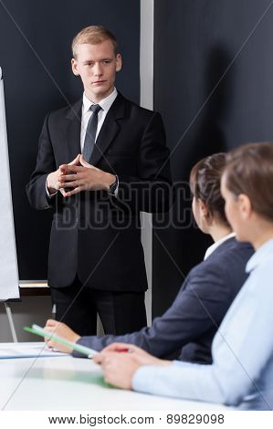 Manager Standing During Business Appointment
