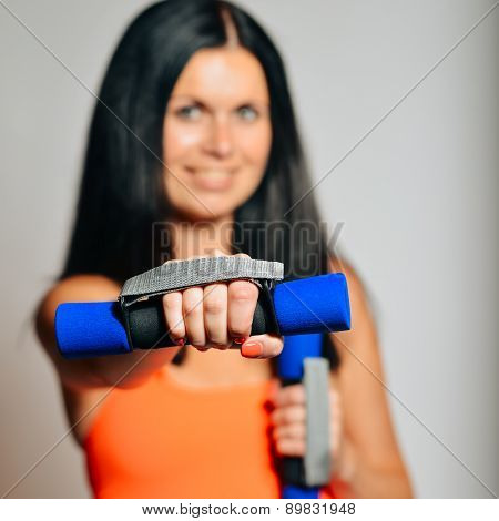 Fitness Woman Lifting Dumbbells