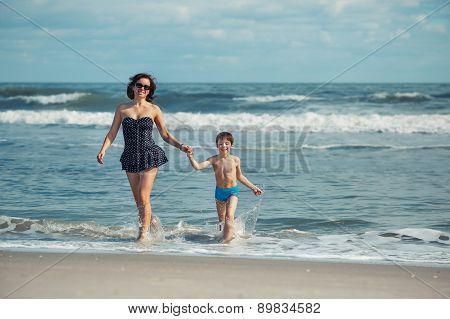 Mother and son having fun on a tropical beach