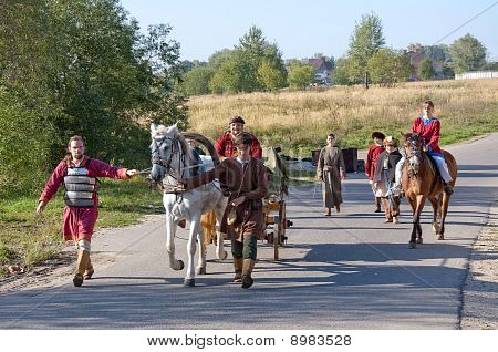 People, Horses And Cart