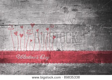 Valentines graphic against overhead of wooden planks