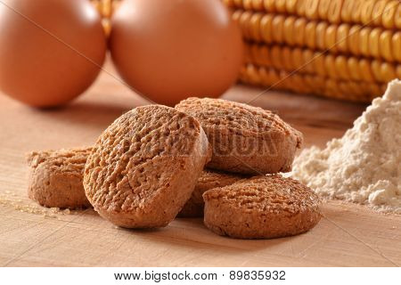 Heap of cereal bran cookies and ingredients background.