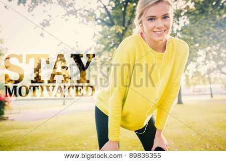 Active cheerful blonde pausing after a run against stay motivated