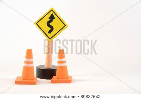 Toy road sign and cones
