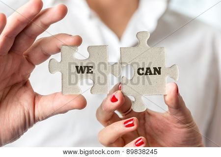 Hands Holding Puzzle Pieces With We Can Message