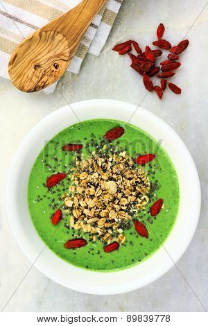 Green smoothie bowl with superfoods and granola