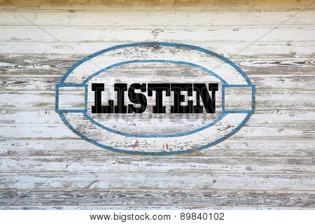 Listen road sign on shed side