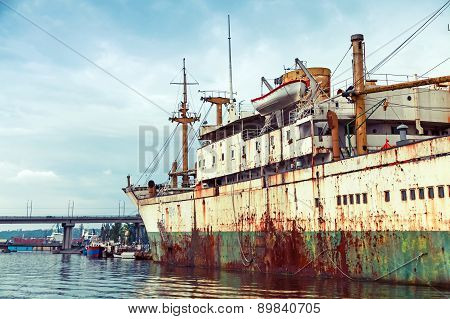 Old Abandoned Rusted Ship Stands Moored In Varna