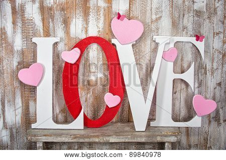 Love Word With Hearts On Wooden Planks Background