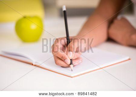 Mulatto Girl Holding Pencil