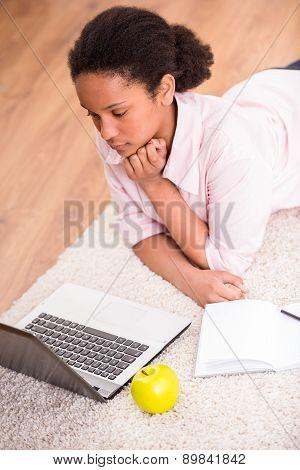 Schoolgirl Using Laptop