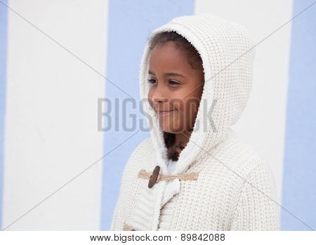 Beautiful african child with blue background outside