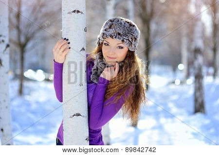 Beautiful Brunette Girl On A Walk In Winter Near The Birch