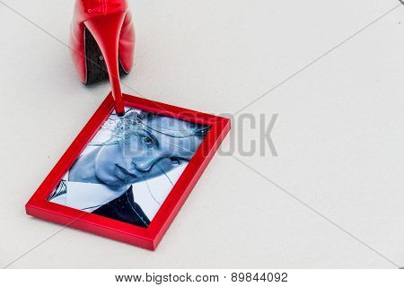zerbrochner picture frames and high heels. symbolic photo for divorce, separation and relationship crisis