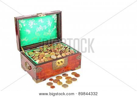 Ancient wooden chest full of euro coins
