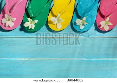 Flip-flops on wooden board