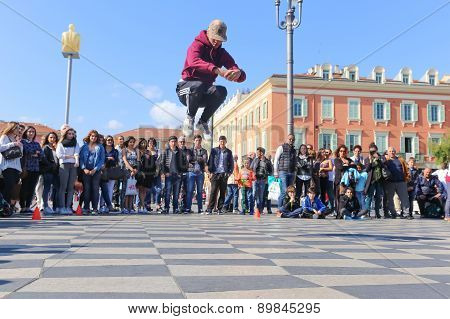 Group Of Street Dancers Performing A Break Dance Routine