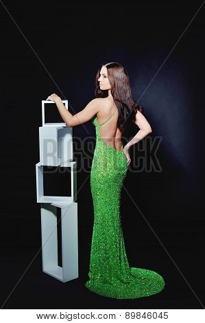 Slender Woman In A Cocktail Dress Green