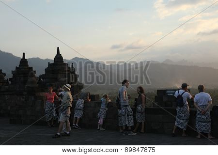 MAGELANG, INDONESIA - AUGUST 1, 2011: Tourists visit the Borobudur Temple in Magelang, Central Java, Indonesia.