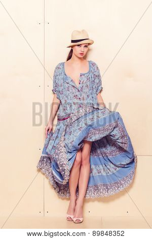 Full body slim woman in blue sundress