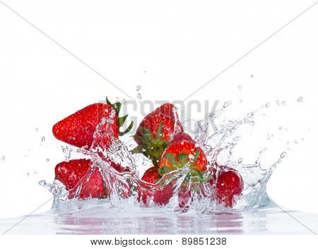 Fresh strawberries in water splash isolated on white background