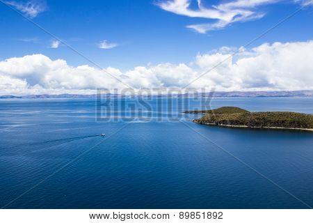 Boat approaching an Island in Lake Titicaca - Copacabana, Bolivia