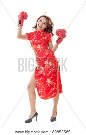 Chinese woman dress traditional cheongsam and boxing gloves, full length portrait isolated.