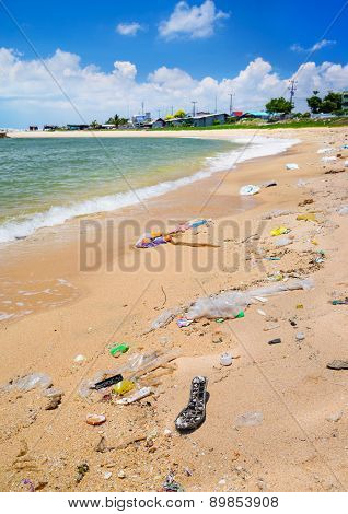 Pollution on the beach of tropical sea.