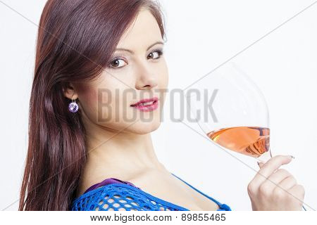 portrait of young woman with a glass of rose wine