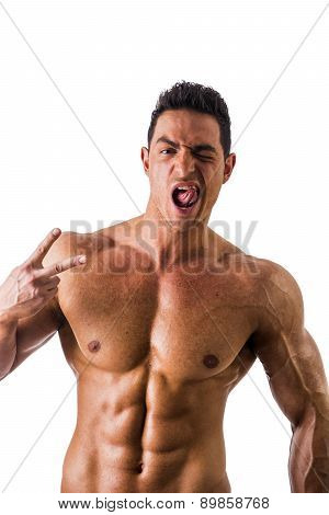 Muscular man shirtless doing two fingers sign for victory