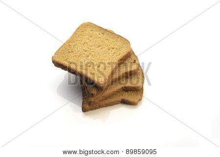 Whole Wheat Brown Bread Slices Stacked Over White Background