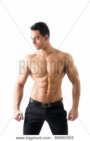 Handsome topless muscular man standing, isolated