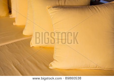 comfort, leisure and interior decoration concept - couch with pillows at hotel