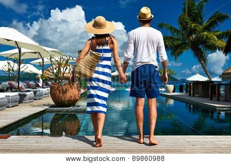 Couple near poolside jetty at Seychelles