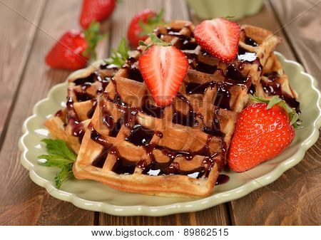 Waffles With Topping And Strawberries