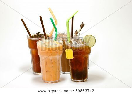 various types of iced tea in glasses over white backgrouind