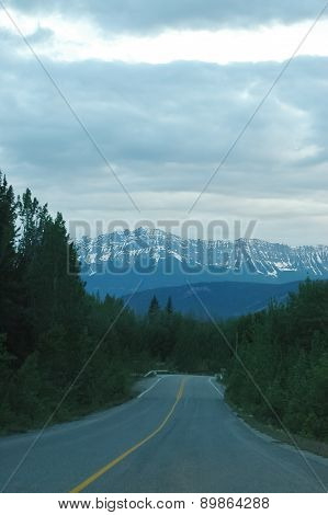 Highway road to snowy Canadian Rocky Mountain