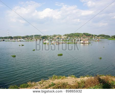 Group Of Floating House On Lake In Southern Vietnam