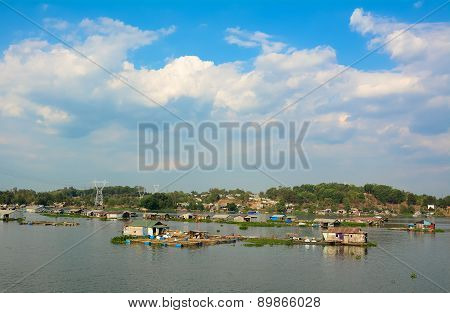 Picturesque Landscape With Power Lines Through Lake