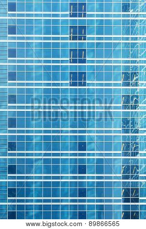 Reflection In Blue Glass Wall Of An Modern Office Building
