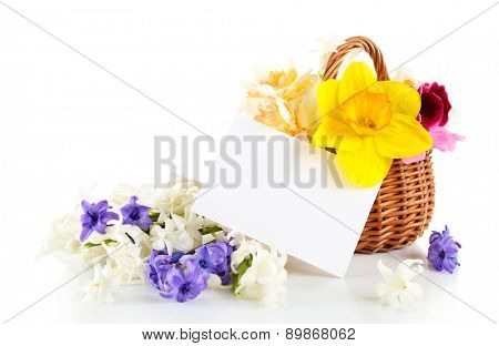 Beautiful flowers in basket with card isolated on white