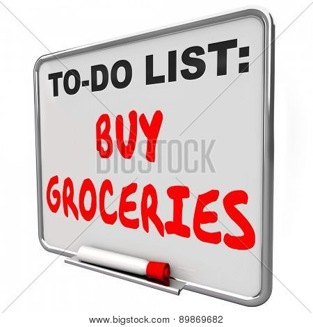 Buy Groceries words written on a dry erase board to remind you to shop for food and other items at sa super market or store