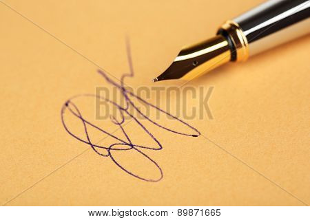 Pen and signature on paper background