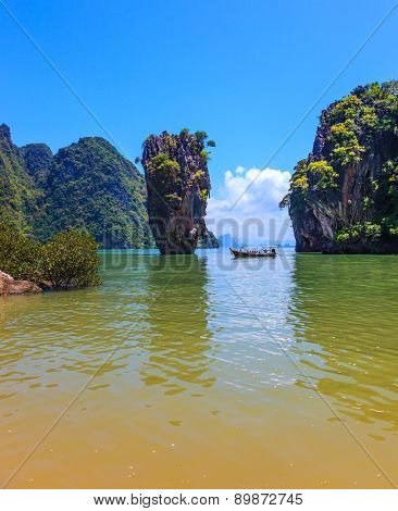 The tourist season in Thailand. Calm and warm Andaman Sea and the quaint island. James Bond Island