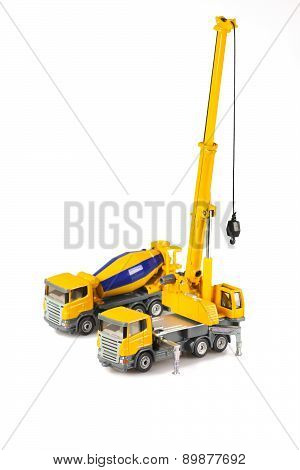 Toy Crane And Concrete Mixer Truck Are Isolated On White Backgroung