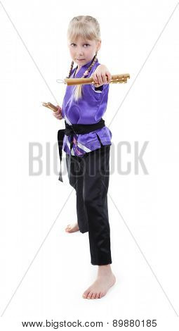 Little girl in kimono doing exercises with nunchaku isolated on white