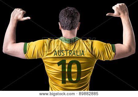 Australian soccer player on black background