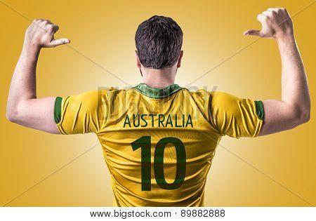 Australian soccer player on orange background