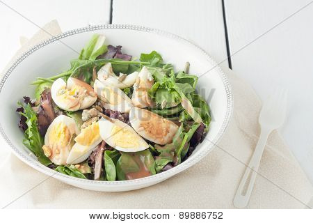 fresh green salad with boiled eggs