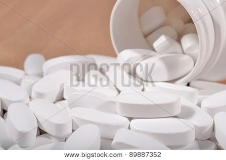 White Pills Spill Out From Bottle